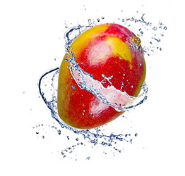 Mango with water swirling around it